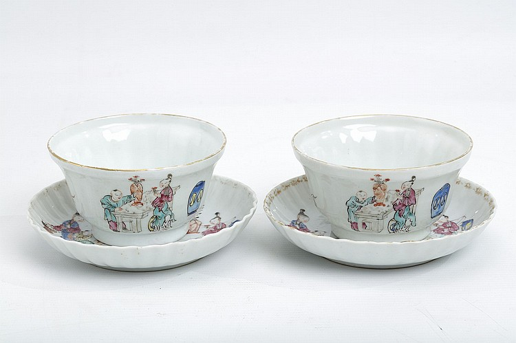 A PAIR OF CHINESE FAMILLE ROSE FIGURATIVE BOWLS AND SAUCERS.   Qing Dynasty, 18th Century.   The saucers painted and gilded with ladies and boys with a dog, elements of the composition repeated around the exterior of the cup, 6cm H, 10.5cm diameter, the saucers 13cm diameter. (4)   ?18?? ??????????