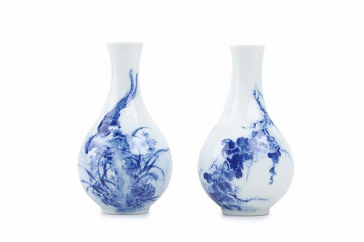 A CHINESE PAIR OF BLUE AND WHITE VASES.   Republican era.   Of pear shaped form with a spreading neck, each painted with birds on a leafy branch, apocryphal Da Qing Qianlong nianzhi mark to base, 14cm H. (2)   ???? ??????