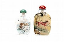 TWO CHINESE INSIDE-PAINTED SNUFF BOTTLES.   20th Century.   One depicting a lion, the other a dog, 8 ? 9cm H.   (2)   £200 ? 300   ???????