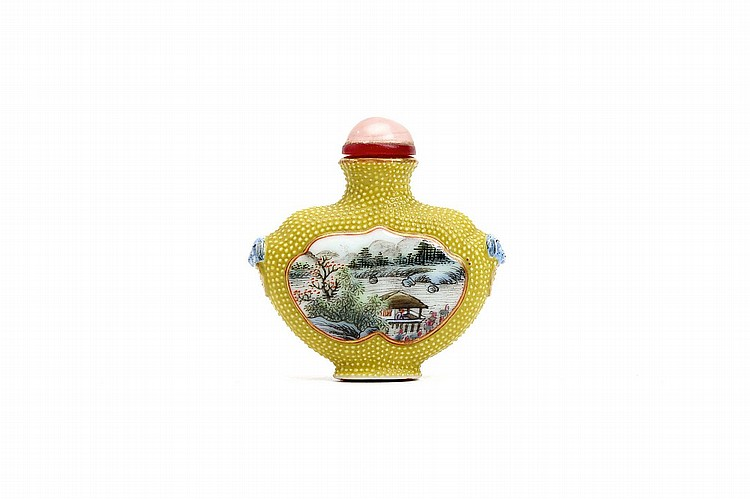 A CHINESE PORCELAIN SNUFF BOTTLE.   19th / early 20th Century.   Of flattened heart shape, each side with a raised moulded shaped panel, one side with a landscape painting within a shaped cartouche, the reverse with a calligraphic inscription, reserved on a dotted yellow ground, possibly imitating sharkskin, the narrow sides with blue enamelled lion-mask fixed-ring handles, Qianlong nianzhi mark to base, stopper, 5.5cm H.   ???????? ?????   Literature: For a similar bottle see Christie's, The Edmund F. Dwyer Collection, 12 October 1987, lot 98.