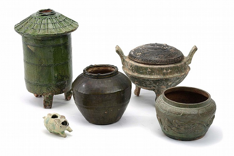 A COLLECTION OF FIVE CHINESE GREEN-GLAZED WARES.   Han Dynasty.   Comprising a grain tower, with tripod bear-form feet, two jars, a censer and a model of a pig, 6-29cm H. (5)   ? ??????