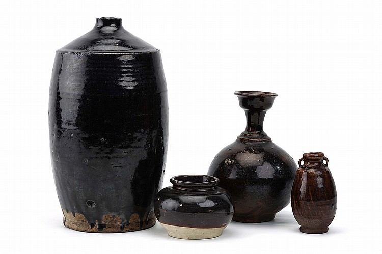 A COLLECTION OF CHINESE BROWN-GLAZED VESSELS.   Yuan Dynasty and later.   Comprising jars and bottles, 8-33cm H. (4)   ???? ???????