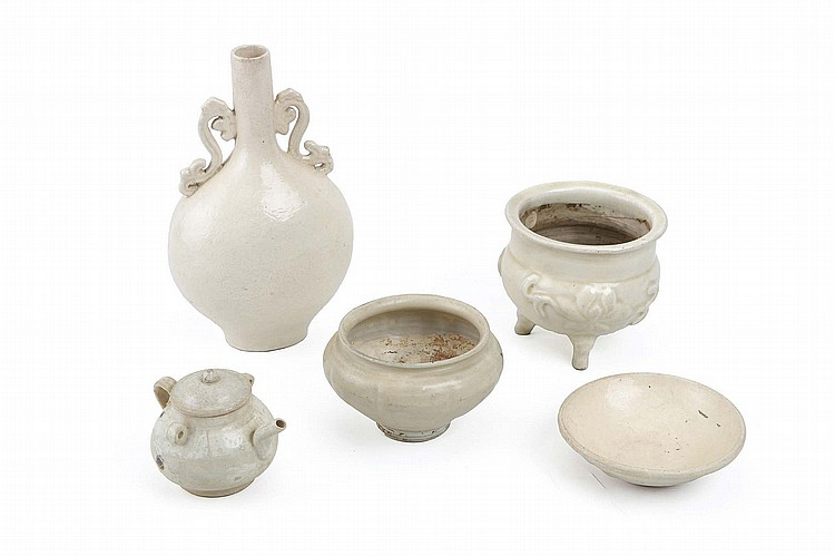 A COLLECTION OF FIVE CHINESE WHITE-GLAZED CERAMICS.   Yuan Dynasty and later.   Comprising a pear-shaped vase with scrolling handles with a dragon pattern impressed on the body, together with a tripod censer with moulded lotus flowers, a bowl, a jar and a water dropper and cover, 9-26cm H. (5)   ????? ??????