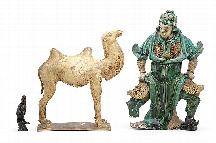 A CHINESE POTTERY CAMEL, A GLAZED POTTERY WARRIOR AND A BRONZE GUANYIN. Tang/Ming/Qing Dynasty. 38 / 42 / 13cm H. (3) Provenance: Collection of Michael Donnellan (1915–1985), couturier, thence to the present owner. ?/?/??  ??????????????????