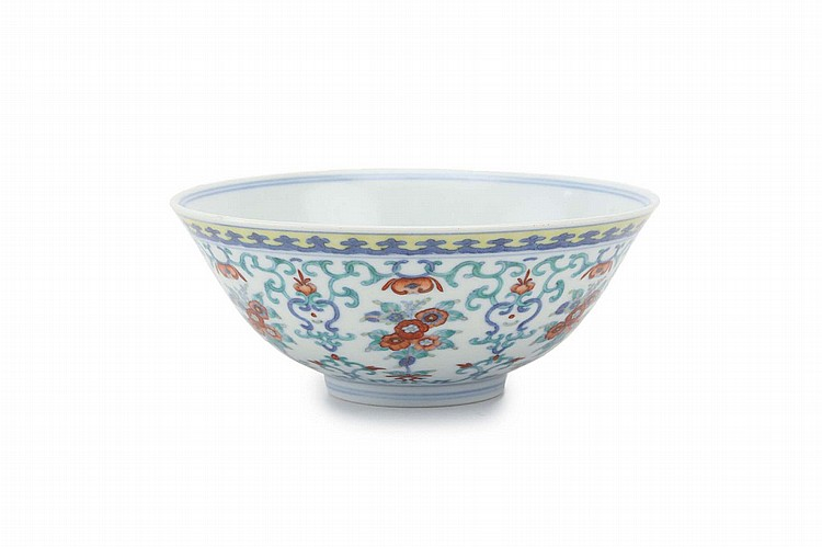 A DOUCAI BOWL. Qing Dynasty, Daoguang mark and period. The steep sides decorated on the exterior with a continuous design of floral bouquets and interlocking leafy scroll, underglaze blue seal mark to base, 6cm H, 15cm diameter. Provenance: Private collection prior to 1930. ? ?? ????? ?????????