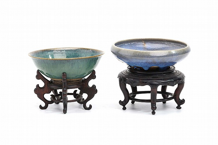 TWO CHINESE JUN-STYLE FLAMBÉ-GLAZED BOWLS. Late Qing Dynasty. With carved wooden stands, 16cm diameter. (2) Provenance: Collection of Herbert Dixon Summers (1871-1953), Secretary Directorate General of Posts Peking, and family, thence by descent to the present owner. ??? ??????