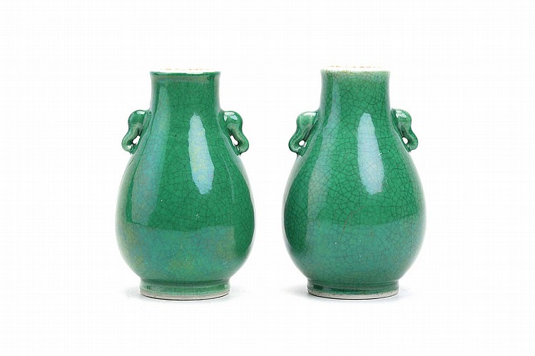 A PAIR OF CHINESE APPLE-GREEN-GLAZED VASES. Qing Dynasty. Of pear-shaped form with elephant head handles to the shoulders, 14cm H. (2) ? ???????