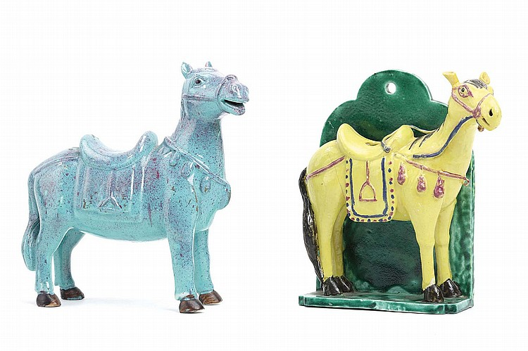A CHINESE ROBINS-EGG-GLAZED FIGURE OF A HORSE TOGETHER WITH A POLYCROME-GLAZED HORSE.   19th / 20th Century.   Each standing four-square fitted with a saddle, the yellow glazed horse standing on a green-glazed stand with attached back panel, 19cm H. (2)   19?20?? ???????????