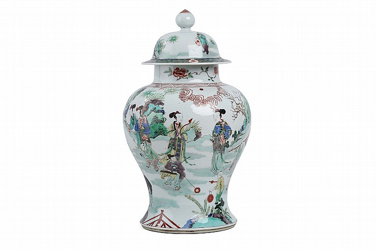 A CHINESE FAMILLE VERTE BALUSTER-FORM FIGURATIVE VASE AND COVER. Qing Dynasty. Painted with a continuous exterior scene of ladies with boys at play, the domed cover surmounted by a bud-form finial, 44cm H. ? ???????