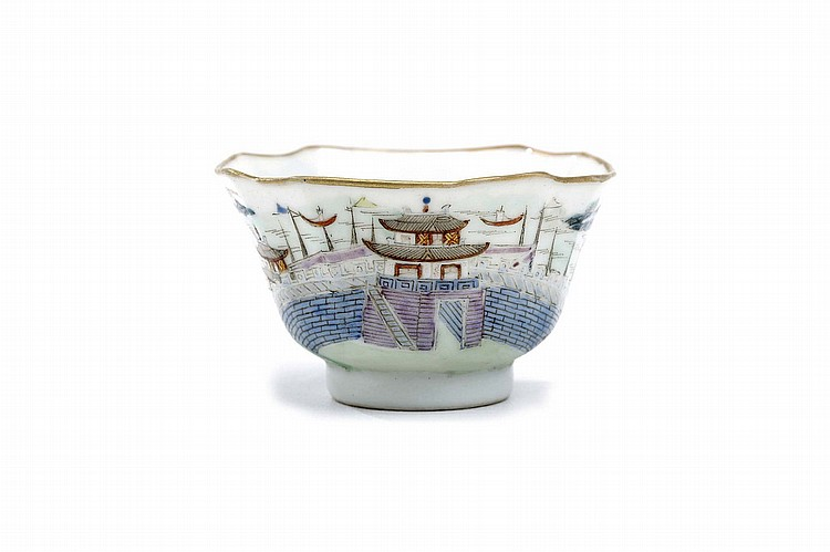 A CHINESE FAMILLE ROSE 'RIVERSCAPE' TEACUP.   Qing Dynasty.    The exterior brilliantly enamelled with a continuous scene of the Jiangnan region, the houses on scattered islands amidst watery landscapes, nanpu gui fan mark to base, 3.5cm H, 6cm diameter.    ? ?????? ???????
