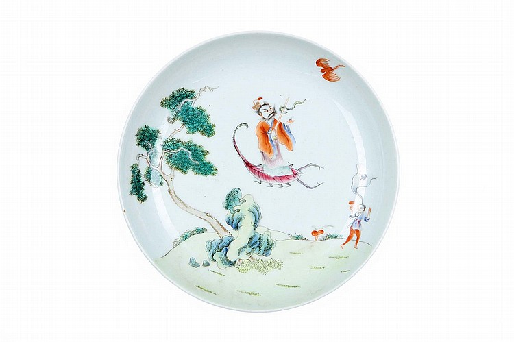 A CHINESE FAMILLE ROSE 'FIVE POISONS' DISH. Early 20th Century. The interior painted with the Daoist Zhang Daoling riding on the back of a scorpion a sword in his right hand with a snake coiled around the blade, an iron red creature overhead whilst below a three-legged toad sits on a rock beneath a pine tree, with a small boy also standing on the ground holding a lingzhi spray, iron red Da Qing Daoguang nian zhi mark to base, 16.5cm diameter. 20??? ?????????? Zhang Daoling and the 'Five Poisons' is an important motif symbolic of combating evil and is associated with the Duanwu festival on the fifth day of the fifth month of the Chinese lunar calendar. The five poisons, represented by the snake, centipede, scorpion, lizard and toad, are said to come out of hibernation at this time and their slaughter is an important means of conquering the evil they represent.