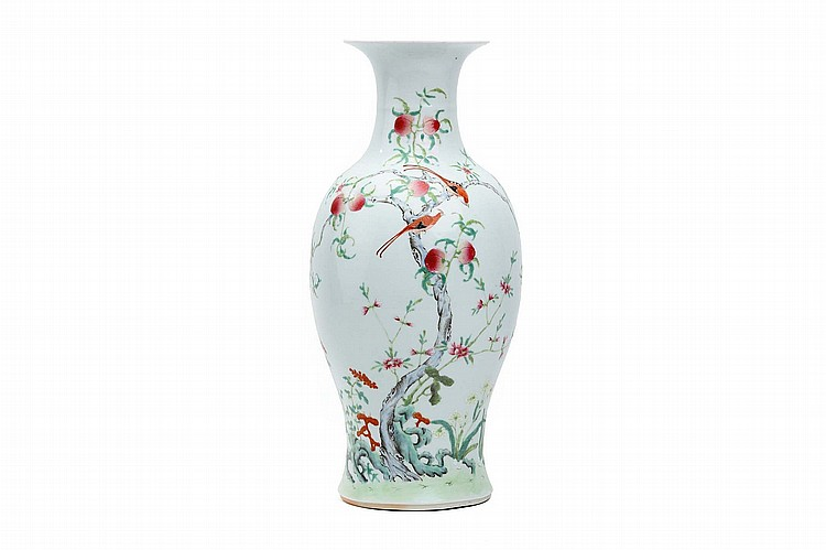 A CHINESE FAMILLE ROSE 'PEACHES AND BATS' VASE. Early 20th Century.                                                 The body of the baluster form vase decorated with a peach tree trunk emerging from a rocky outcrop with attendant flowers and lingzhi fungal spray, the trunk with fruiting branches and supporting two exotic birds, 46cm H. ???? ?????