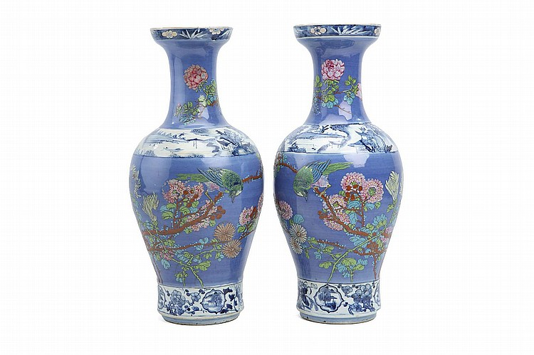 A PAIR OF CHINESE UNDERGLAZE BLUE ENAMELLED FAMILLE ROSE VASES. Qing Dynasty. Decorated to the body and neck with birds and flowers on a blue ground, with a blue and white band to the base, rim and shoulders, decorated with landscape and floral