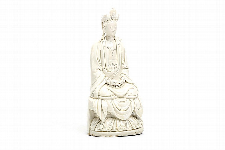 A CHINESE BLANC-DE-CHINE MODEL OF A GUANYIN.   Qing Dynasty, 18th Century.   Seated in long flowing robes on a lotus throne, 30cm H.   ? ???????