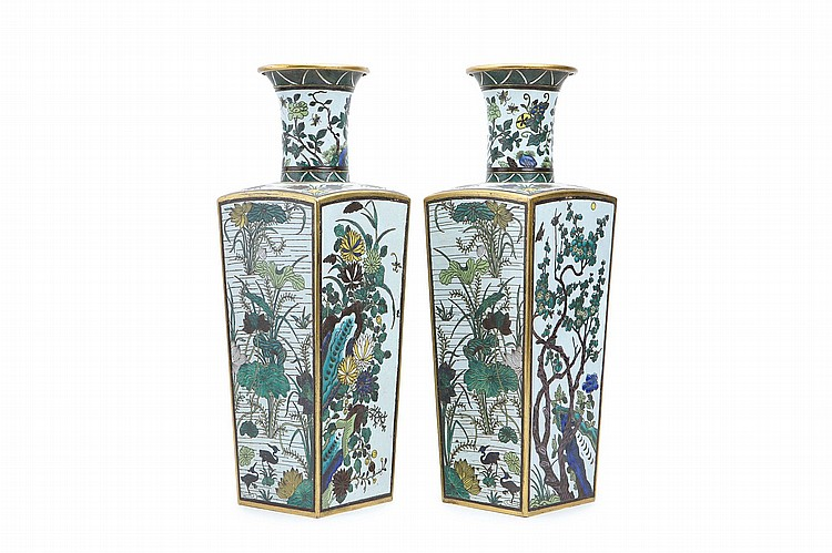 A PAIR OF CHINESE SQUARE SECTION CLOISONNÉ ENAMEL VASES.    Qing Dynasty, 19th Century.   Of rectangular section with bevelled corners and tall straight sides, domed shoulders and a trumpet neck, the four faces of the body decorated with floral scenes, the shoulders and neck similarly decorated, gilding to the edges and rim, Kangxi nianzhi mark to base, 49cm H. (2)   Provenance: From a collection of a stately home in the south of England, by repute.   ? 19?? ????????   Literature: A single vase of similar proportions, form and design but on a yellow ground is housed in the Chinese Imperial collection, illustrated Compendium Collections in the Palace Museum: Enamels, volume IV, cat no 226.