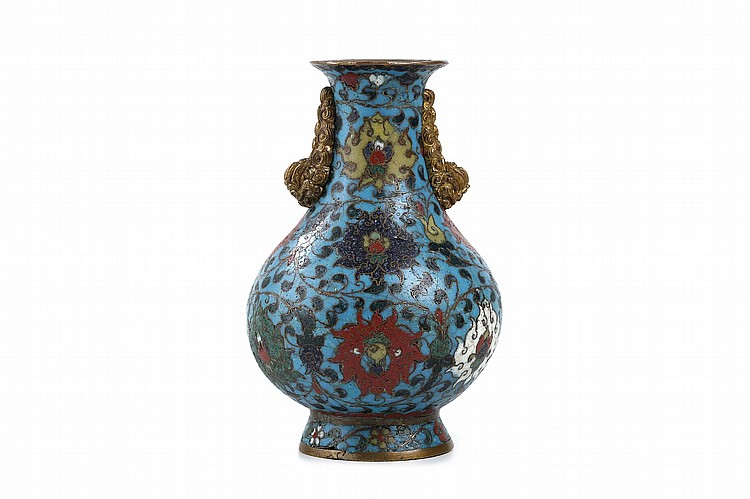 A CHINESE CLOISONNÉ ENAMEL VASE.   Ming Dynasty.   Of pear shaped form with three rows of lotus flowers borne on scrolling foliage on a turquoise ground, the spreading foot with a band of smaller flowers, the shoulder with a pair of gilt bronze lion head handles, two character Jingtai mark to base, 17cm H.   ? ????????