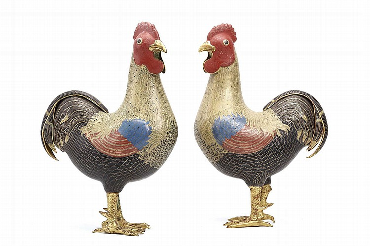 A PAIR OF CHINESE CLOISONNÉ ENAMEL COCKERELS.   19th / 20th Century.  Each bird modelled with head turned in mirror image, standing alert with short gilt-bronze naturalistically detailed scaly feet and claws, the head crowned with a prominent red comb and with a pointed gilt-bronze beak, with yellow feathers down the neck, blue and red wings, and with black feathers to the tummy and tail, 39cm H. (2)   ? ????????