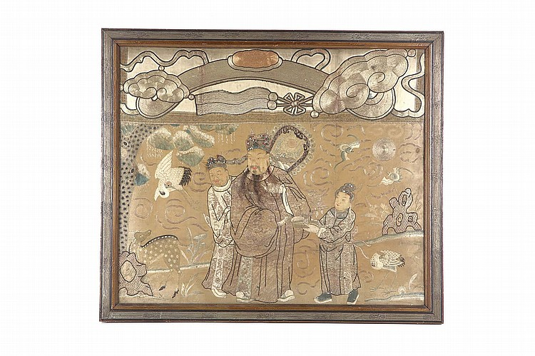 A CHINESE TEXTILE PANEL.   Qing Dynasty.   Embroidered with figures with painted padded faces, beside bats, a crane and deer, below a ruyi sceptre worked in couched gold thread, 74 x 86cm.   ? ??