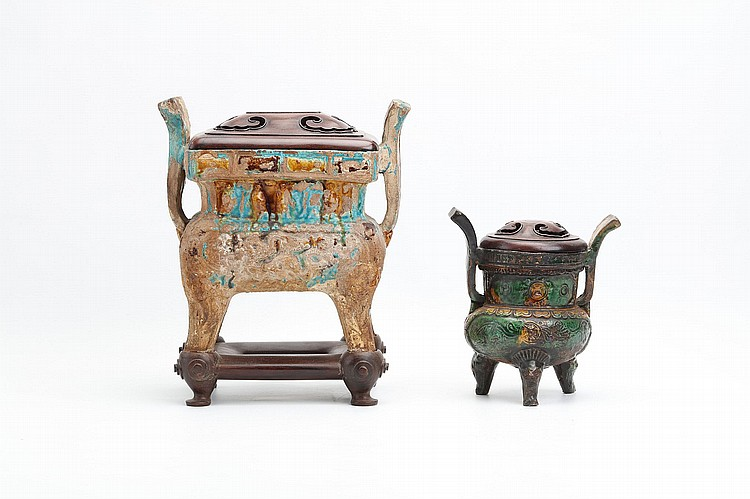 TWO CHINESE SANCAI-GLAZED CENSERS.   Ming Dynasty.   One of rectangular form with flaring handles, fitted wooden stand and cover, 30cm H, together with a tripod censer with flaring handles, circular wood cover, 17.5cm H, 10cm diameter. (2)   Provenance: Collection of Mr (1926 –) and Mrs Chen (1930 –).   ? ????????