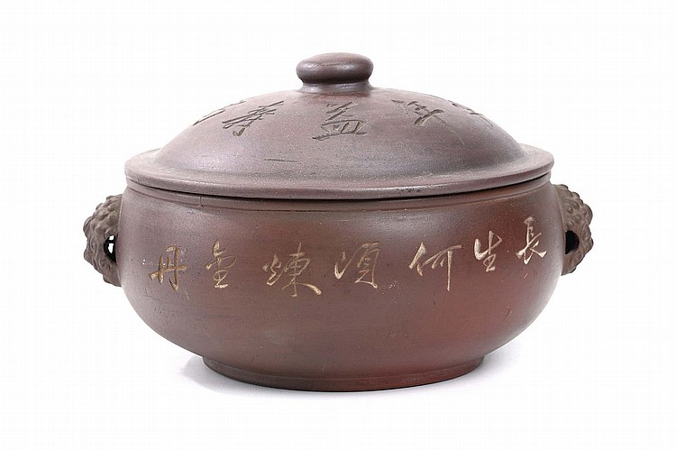 A CHINESE JIANSHUI ZISHA COOKING POT AND COVER, BY MING YUANJING.   20th Century.   With dragon-head handles, the pot and cover decorated with calligraphic inscriptions, 16cm H.   Provenance: Collection of Mr (1926 –) and Mrs Chen (1930 –).   ???????????   ???    ??: ????? ?? ???? ???????, ???????