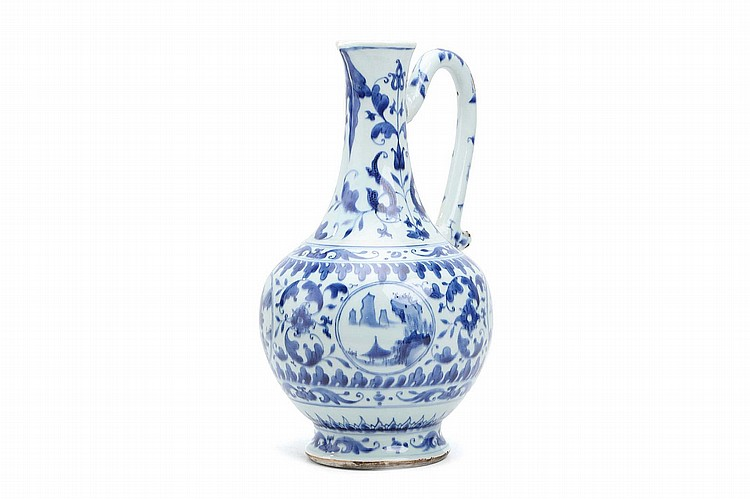A CHINESE BLUE AND WHITE EWER. Transitional Period. The globular body decorated with circular panels enclosing landscape scenes, reserved on scrolling foliage, rising to a waisted neck, with a C-form handle, 34cm H. ???? ???