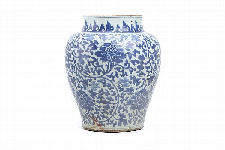 A CHINESE BLUE AND WHITE JAR. Transitional Period. Of baluster form, decorated with a continuous pattern of lotus flowers borne on leafy foliage, 40cm H. ???? ????????