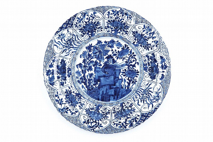 A PAIR OF CHINESE BLUE AND WHITE 'PHEASANT ON ROCKS' DISHES.   Qing Dynasty, Kangxi era.   The central roundel enclosing the pheasant on rocks design, enclosed by a moulded band of lappets enclosing floral designs, within the foliate rim, 28cm diameter. (2)   ? ?? ????????