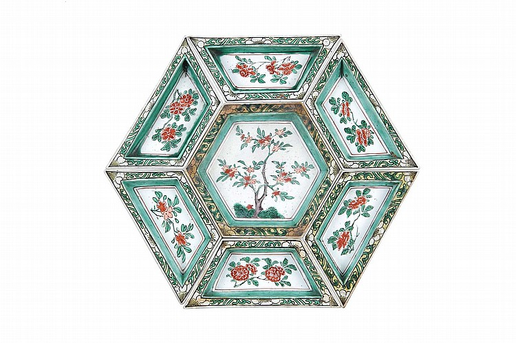 A CHINESE FAMILLE VERTE SWEET MEAT SET.   Qing Dynasty, Kangxi era.   Comprising a central hexagonal dish surrounded by six rhombus-form dishes, each with flowers to the centre, surrounded by a white and green border of prunus flower heads and scrolling foliage, 26cm diameter. (7)   ? ?? ??????????