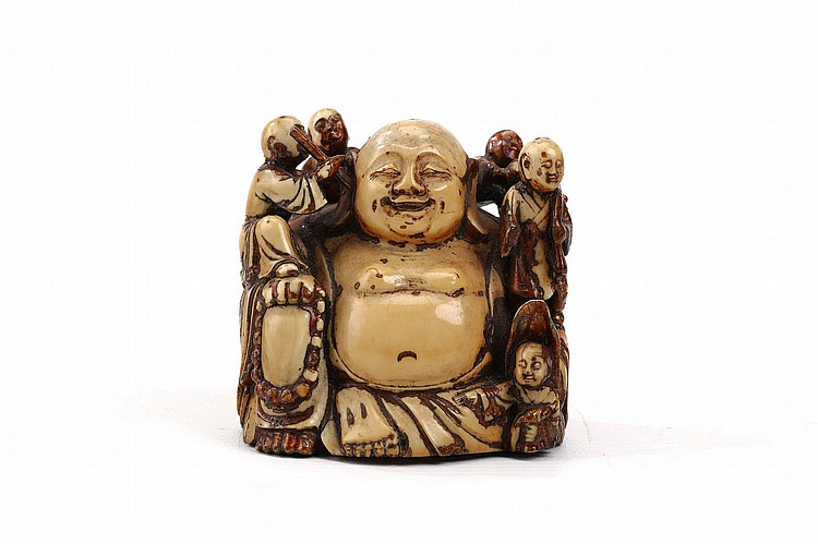 A CHINESE GILT IVORY CARVED BUDDHA WITH BOYS.   Qing Dynasty, 18th Century.   The open chested Buddha with the right hand resting on the raised right knee and holding prayer beads, whilst five boys clamber over his body, one earnestly engaged in cleaning the Buddha's ear, 7.5cm H.   ? 18?? ?????????