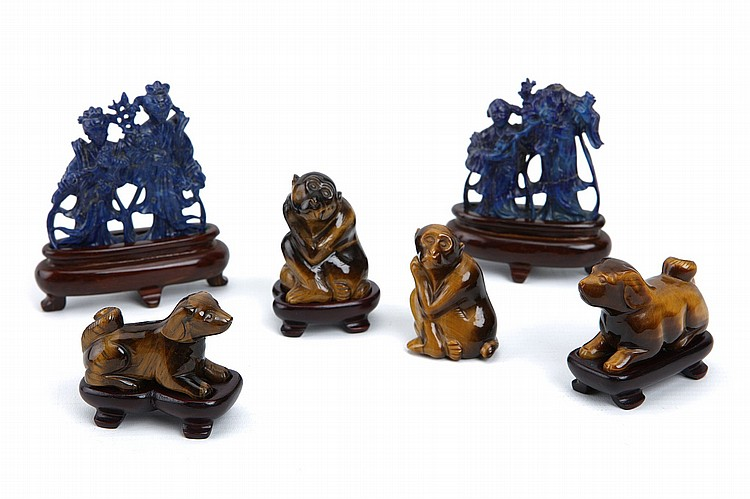 A PAIR OF CHINESE LAPIS LAZULI 'LADIES', A PAIR OF TIGER-EYE CARVED MONKEYS AND A PAIR OF CARVED TIGER-EYE DOGS. Second half of 20th Century. All but one monkey with wood stands, 3-6cm H. (6) 20???? ????????????????????