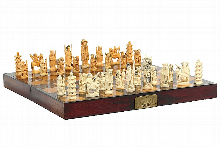 A CHINESE CARVED IVORY CHESS SET.   Republican era.   The thirty-two pieces well carved , one side stained, fitted within a board, the pieces 5.5-9cm H.   Provenance: Brian Pearson (1926 – 2003) Collection, acquired in China between 1945 and 1946.   ???? ???????