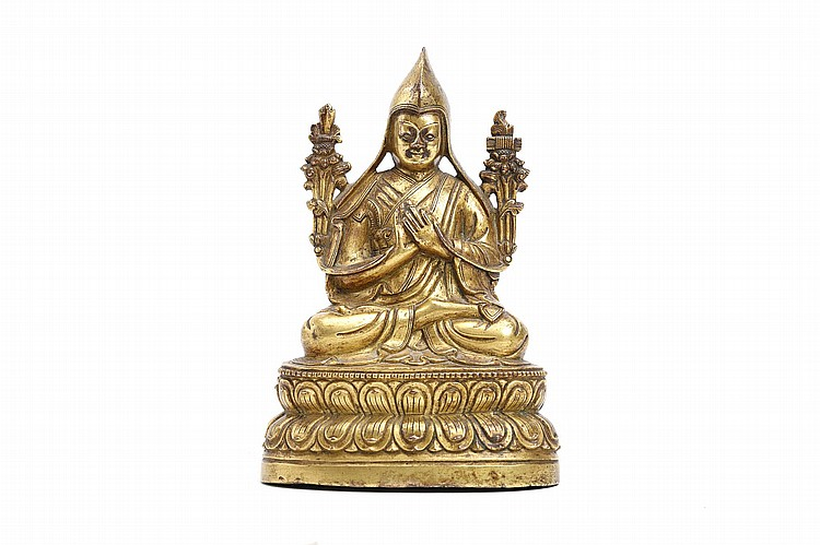A TIBETAN GILT BRONZE FIGURE OF TSONGKHAPA.   19th Century.   Seated on a double lotus throne with his hands dharmachakra mudra, a sword and book raised on lotuses at the shoulders, 13cm H.   19?? ?? ???????