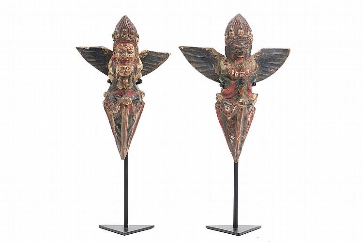 TWO TIBETAN CARVED AND POLYCHROME WOOD PHURBAS, DEPICTING VAJRAKILA IN YAB-YUM. 19th Century. Each carved and painted with the fierce, winged deity embracing his spouse, holding a miniature phurba in his hands, and placed above the triangular blade of the dagger, 17.5cm H. (2) 19?? ????????