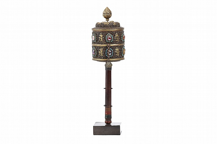 A PRAYER WHEEL.   19th / early 20th Century.   With gilt brass decoration on a copper base, with two registers of semi-precious stones, and one ivory or bone plaque with a carved Bodhisattva, probably original, woodblock printed prayers enclosed, 34cm H.   19/20?? ?????
