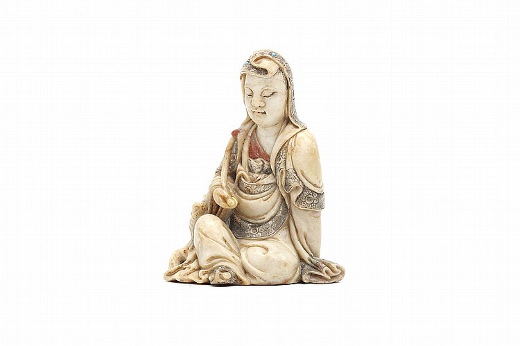 A CHINESE SOAPSTONE CARVING OF GUANYIN.   17th Century.   Seated in royal ease against a rocky base, the eyes downcast, a serene expression on the face, the right knee is raised and the left arm tucked behind beneath long flowing robes, the right arm holding a branch, Wang Xuanzi mark on the back, 8cm H.   17?? ???????????  ??????