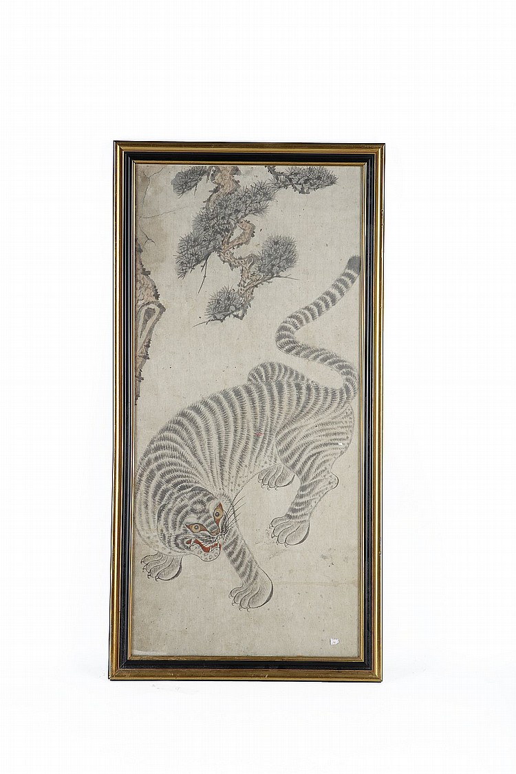 A KOREAN TIGER PAINTING. The beast dramatically coiled beneath a tree branch, ink and colour on paper, framed and glazed, 89 x 45.5cm. Provenance: London private collection; Christie's South Kensington, Oriental Ceramics and Works of Art, 14 May 1992, lot 159. ??