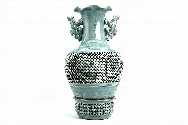A CELADON VASE AND STAND. 20th Century. The body and stand with pierced openwork in simulation of basketwork, the shoulders with seated animal-form handles below the foliate rim, 68cm. (2) 20?? ???????