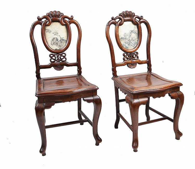 A PAIR OF CHINESE EXPORT ROSEWOOD CHAIRS.   Early 20th Century.   Modelled after a European design, each oval panels inset with ink paintings, 112cm H. (2)   Provenance: Chinese restaurant exhibition 1921 metal plaque to the reverse of each chair.   20???? ??????