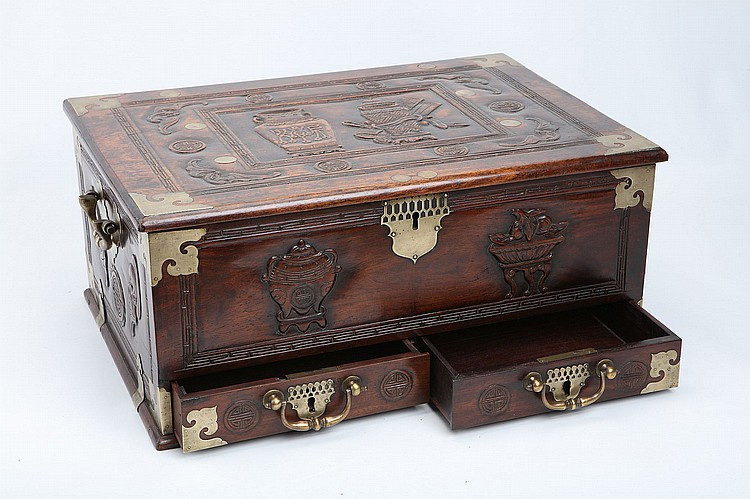 A CHINESE HARDWOOD CHEST.   Qing Dynasty, or later.   The cover and sides incised variously with treasures, bats and stylised fu characters, the interior of the hinged cover with inlaid with the date, ano 1739, 24 x 39x 55cm.   ????? ???