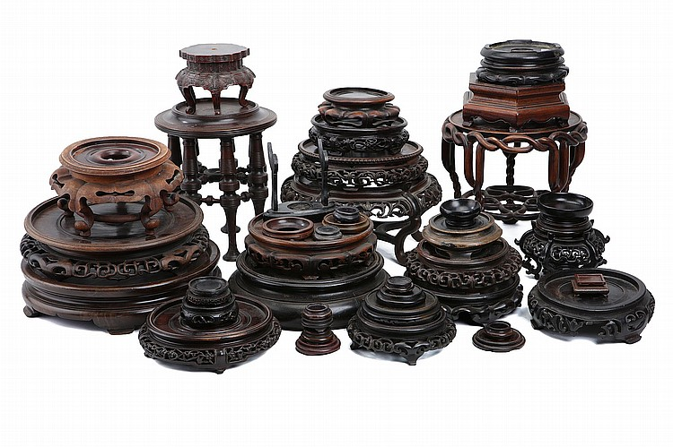 A COLLECTION OF CARVED WOOD STANDS. (Qty) ??????