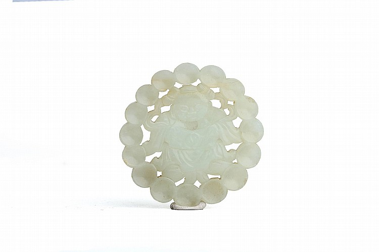 A CHINESE JADE OPENWORK CIRCULAR PLAQUE.   Qing Dynasty.    Both sides carved and pierced with a body standing within a ring of adjoined circles, 6.5cm diameter.   ? ???????