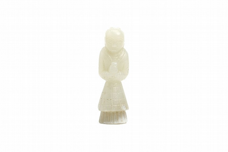 A CHINESE JADE CARVING OF A STANDING FIGURE.   The figure standing with hands together holding a vase, 5.5cm H.   ? ??????