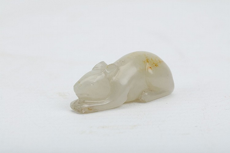 A CHINESE JADE CARVING OF A MOUSE.   Seated with legs tucked in beneath and head lowered, 4cm long.   ??