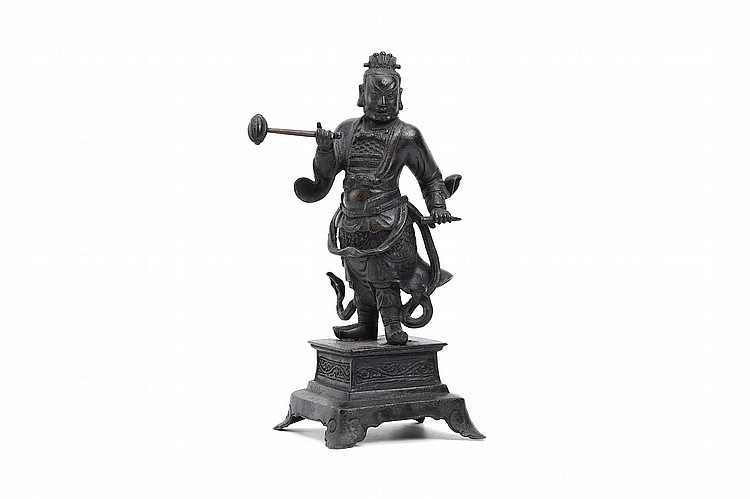 A CHINESE BRONZE FIGURE OF GUANDI.   Ming Dynasty.   Standing in armoured clothing, a trailing ribbon around the waist, raised on a rectangular plinth, 29cm H.   ? ????