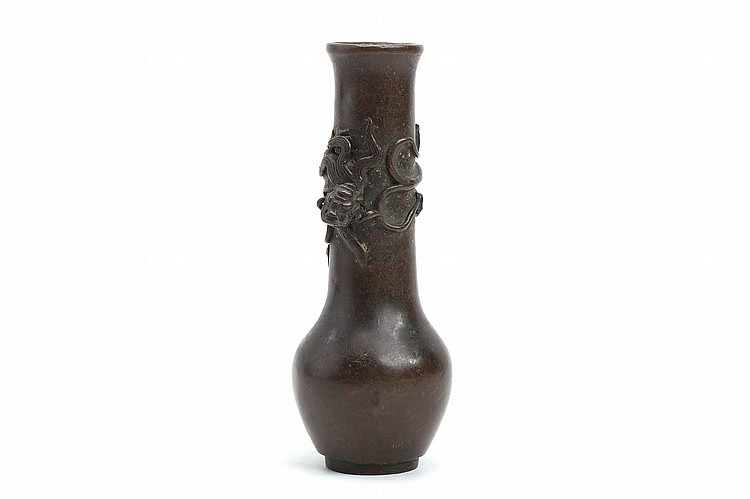 A CHINESE BRONZE TOOL VASE. Qing Dynasty. Of pear shaped form, the long cylindrical neck decorated with a dragon modelled in relief, 22cm H. ? ??????