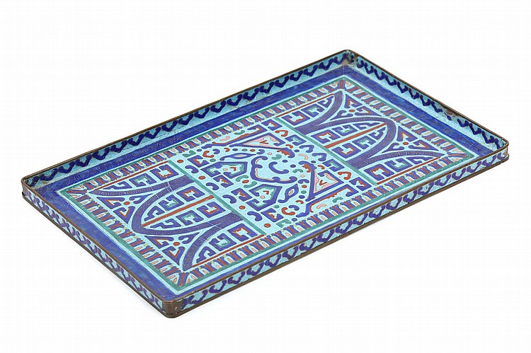 A CHINESE CANTON ENAMEL TRAY. Qing Dynasty, 19th Century. Of rectangular form, decorated with geometric patterns in lapis blue, red, green and pink on a turquoise ground, the rim with a continuous border of ruyi heads, 18 x 30cm. ?19?? ??????????