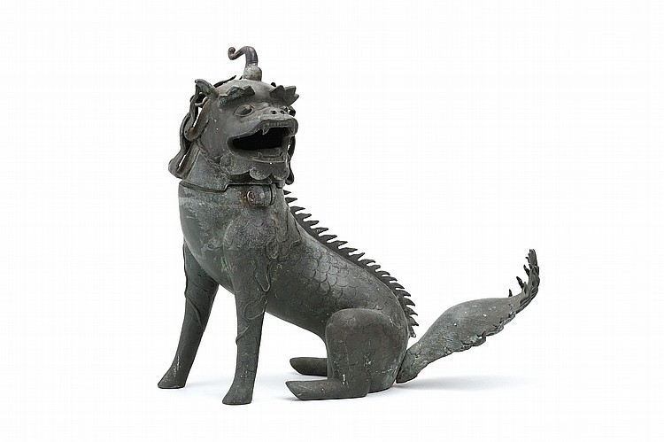 A CHINESE BRONZE 'QILIN' CENSER. Ming Dynasty. Seated on its hind legs, the head turning to the left, hinged to the body to form the cover, the mouth open for the release of smoke, 33cm H. ? ?????