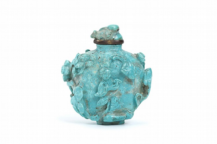 A CHINESE TURQUOISE 'LADIES' SNUFF BOTTLE.   19th / 20th Century.   Deeply incised with a lady holding a lingzhi spray beside a bat on one side and a lady with birds on the reverse, beneath the shade of a pine tree, original turquoise stopper, 5cm H.    Provenance: Collection of P.H. (1926 – 2016).   19/20?? ??????????