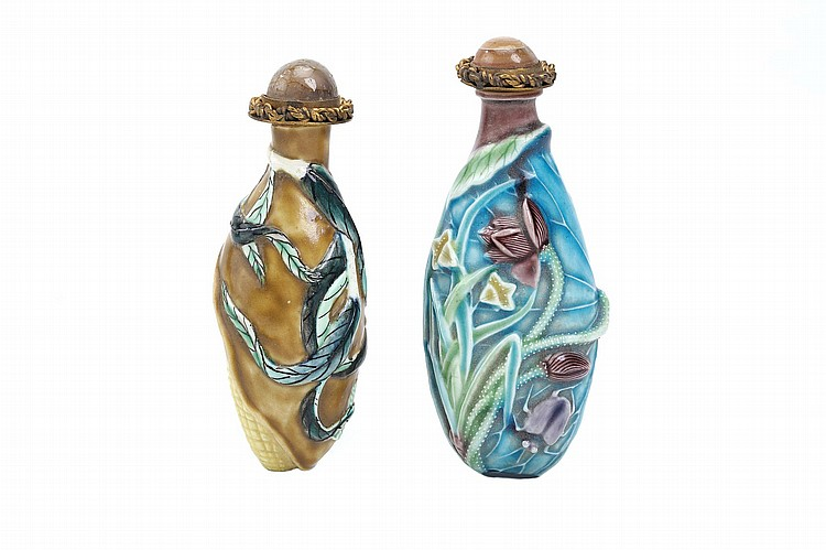 A  CHINESE MOULDED PORCELAIN 'CORN' SNUFF BOTTLE, TOGETHER WITH A 'LOTUS LEAF' SNUFF BOTTLE. Qing Dynasty. The corn bottle moulded and painted as borne on a leafy branch, the other bottle glazed in turquoise, aubergine, green and yellow as a large leaf with conjoined flowering branches, stoppers, 9.5cm H. (2) Provenance: Collection of P.H. (1926 – 2016). ? ?????????????