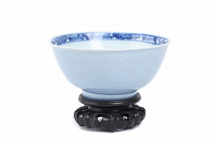 A CHINESE PALE BLUE BACKED BLUE AND WHITE BOWL.   Ming Dynasty.    8cm H, 16.5cm diameter.   Provenance: Collection of P.H.  (1926 – 2016).   ? ???